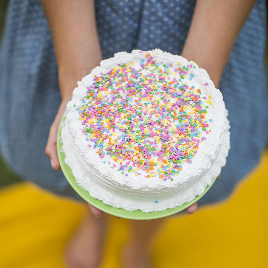 Woman holding a round ice cream cake from Dairee Delite
